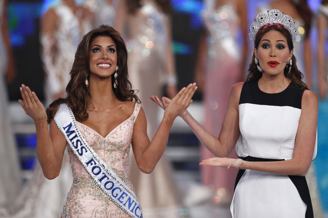 Miss Guarico, Mariana Jimenez, reacts next to Miss Universe 2013, Maria Gabriela Isler, after winning the Miss Venezuela 2014 pageant in Caracas
