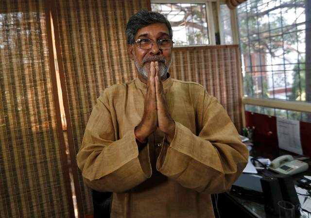 Indian children's right activist Satyarthi gestures as he speaks with the media at his office in New Delhi