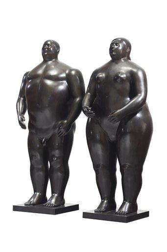 """Foto: En esta imagen difundida por Christie's, las esculturas de bronce """"Adán y Eva"""", de Fernando Botero / AP"""