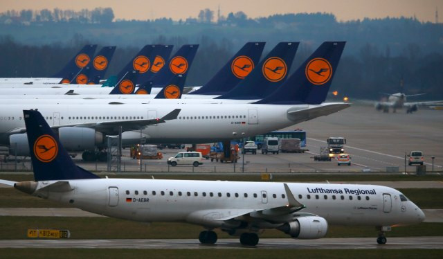Planes of German flagship carrier Lufthansa are parked on tarmac at Munich's airport