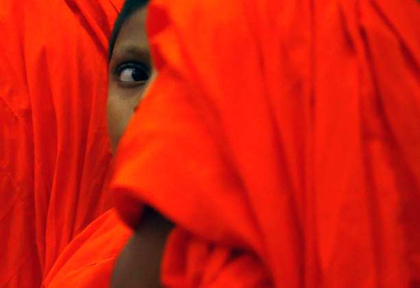 A Buddist monk looks on during the Interreligious Encounter at the Bmich in Colombo
