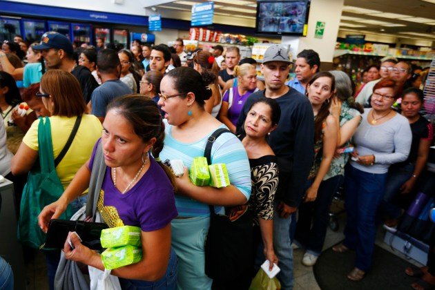 People queue up to pay at a Farmatodo drugstore in Caracas