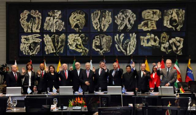 Foreign ministers of the South American bloc UNASUR pose during a photo op at the UNASUR headquarters in Quito
