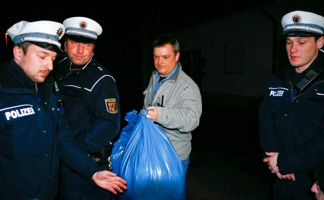 German police officers carry bags out of a house believed to belong to the parents of crashed Germanwings flight 4U 9524 co-pilot Andreas Lubitz in Montabaur
