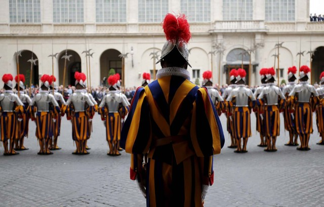 New recruits of the Vatican's elite Swiss Guard stand at attention during the swearing-in ceremony at the Vatican
