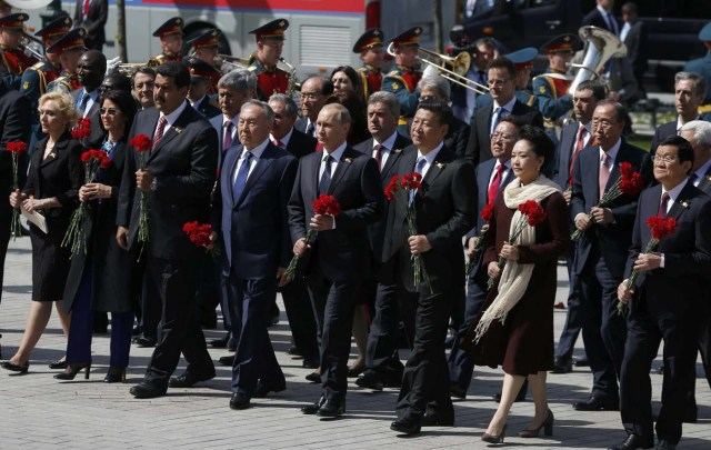 Leaders take part in a wreath laying ceremony on the Victory Day in Moscow
