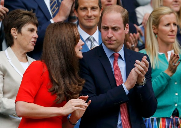 Britain's Catherine Duchess of Cambridge and Prince William (R) applaud as Andy Murray of Britain comes out to play his match against Vasek Pospisil of Canada at the Wimbledon Tennis Championships in London