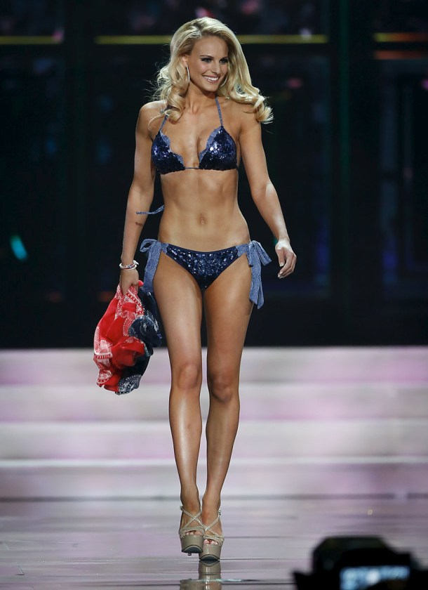 Miss Kentucky USA George walks on stage in a swimsuit during the 2015 Miss USA beauty pageant in Baton Rouge, Louisiana