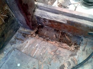 The rotten floor and beam under the compression post