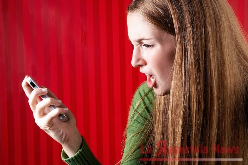 Girl-Angry-at-her-Smartphone-Pure-Emotion