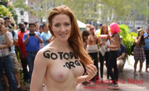 Go Topless Day Pade in New York Featuring: Atmosphere Where: Manhattan, New York, United States When: 23 Aug 2015 Credit: TNYF/WENN.com
