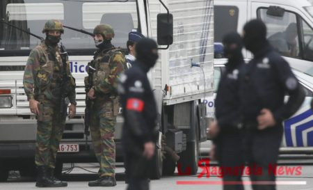 Police officers block access to a shopping mall in Brussels, Belgium, after a bomb scare early Tuesday.