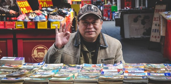 A man standing in front of book store