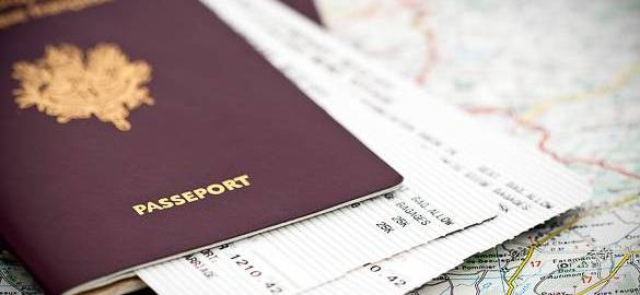 ticket sandwich in a passport on top of a map