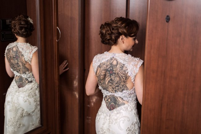 Bride getting ready in mirror at Litchfield camp wedding