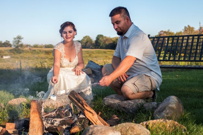 Bride and groom roasting marshmallows at Bunnell Farm in Litchfield