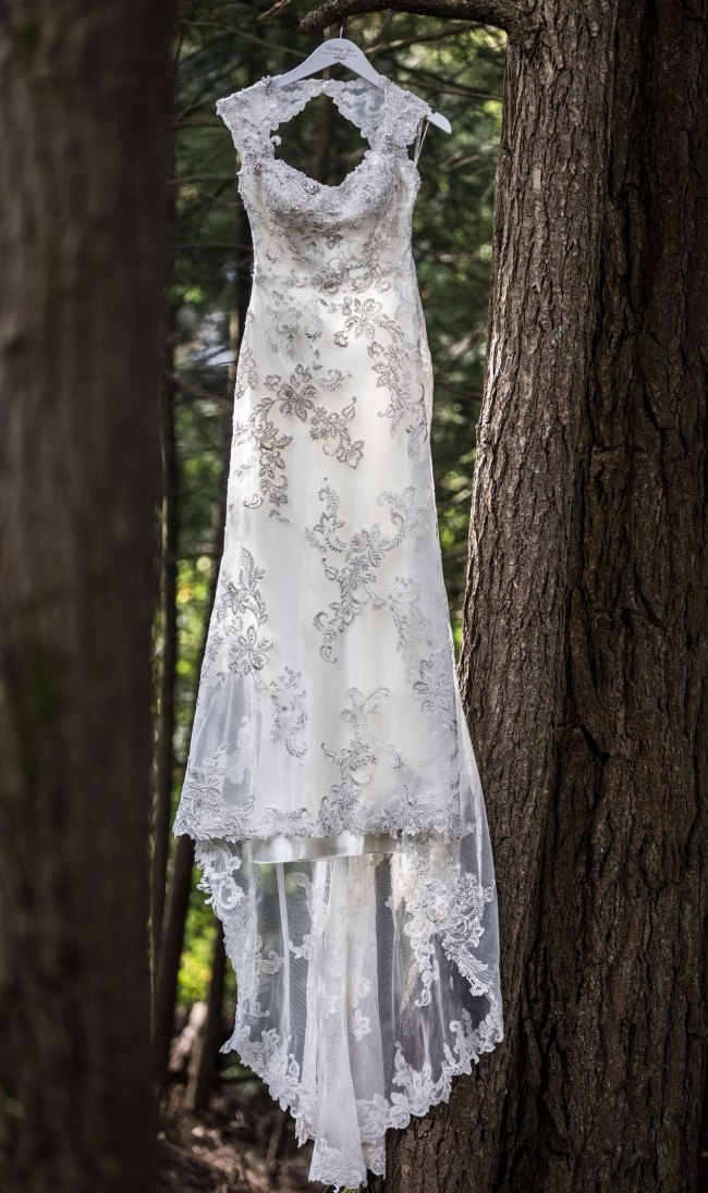 Lace wedding dress hanging from a tree in Litchfield