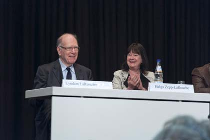 EIRNS/Julien Lemaître  Lyndon LaRouche, at the Schiller Institute conference in Frankfurt, Germany, April 2013, with his wife Helga.