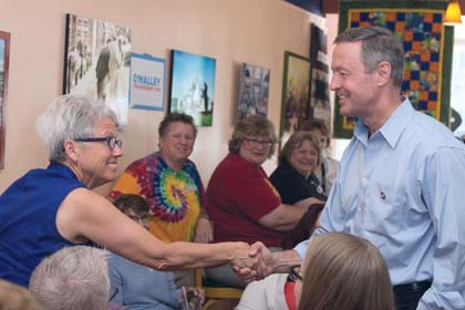 CC/Gregory Hauenstein  Presidential candidate Martin O'Malley, a prominent promoter of Glass-Steagall, greets patrons of Uncle Nancy's Coffeehouse in Newton, Iowa.