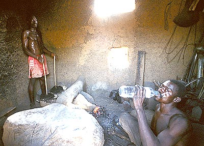 "Among the Bétamarribé, blacksmiths are associated with the solar deity Kuiye who first brought fire to the earth. But Kuiye is also the Bétamarribé Creator God and because the blacksmith creates the scarification tools used ""to make"" men and women, he is highly revered in the community. It should be no surprise that the Bétamarribé word for blacksmith is omato from the verb ma, ""to create."""