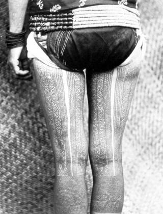 Kayan thigh and knee tattoos,