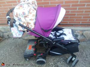Viajar en Avión con un Bebé - Carrito cargado con maletas de mano