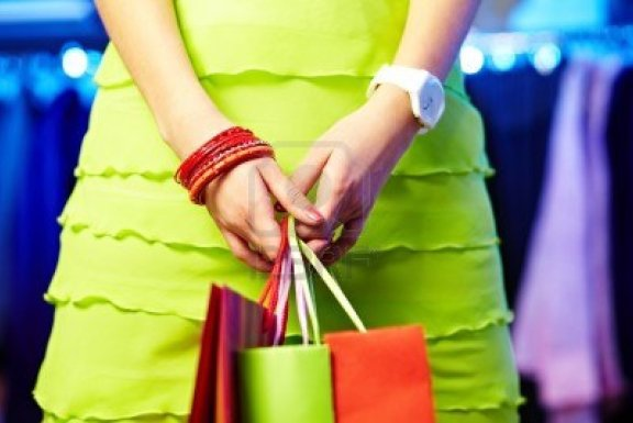 image-of-shopaholic-hands-with-three-shopping-bags