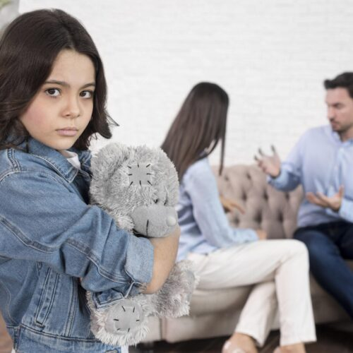 portrait-sad-girl-holding-teddy-bear