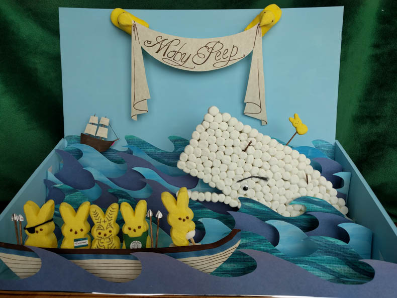 A diorama of Moby Dick, but with marshmallows instead of people and whale.