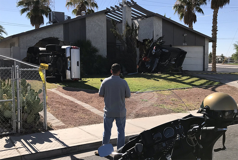 Car and truck slams into home on Sahara