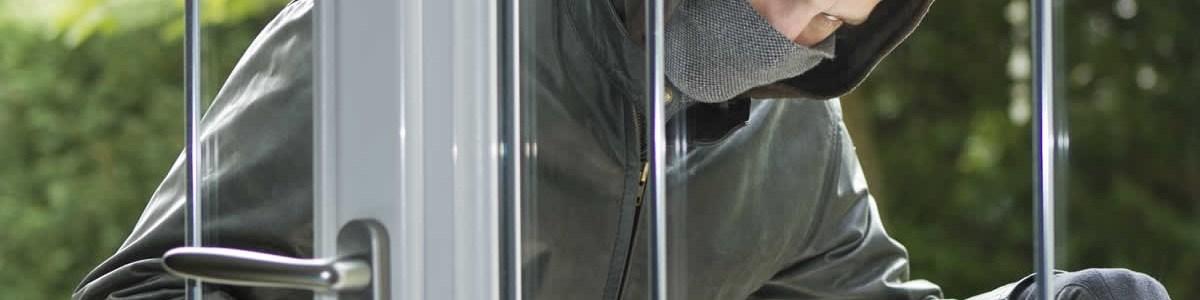 Burglar Using Crowbar to Break Into Residential Home