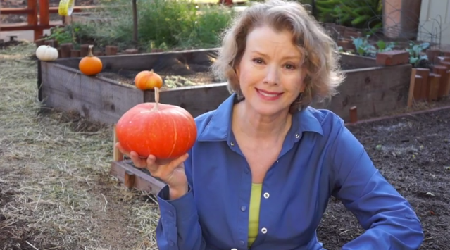Kaye in 2014 with her only homegrown pumpkin and a barren garden