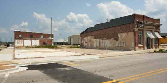 May 2012, corner of Main and Walker Streets. The police station on the corner and other buildings along Main Street have been cleared away.
