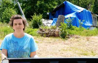 May 2012. Shelia, wife and mother of two, at her destroyed home. She and her family survived the storm at another location. The family is living elsewhere now, and will not be able to rebuild at this site.