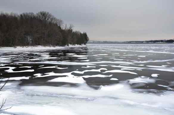 Winter on Lake Champlain with snow and black ice covering a cove