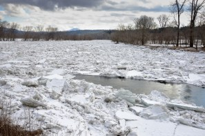 Winooski River ice jam. We might wonder about the pent up force stored in the ice, which wants to head downriver but is held back by a patchwork of ice blocks on ice blocks, all wedged together in one mass.