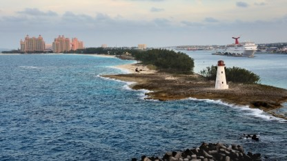 Leaving Nassau—the harbor is on the right, the open sea on the left, and the lighthouse is near the end of the point between the two.
