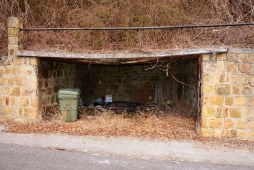 An old garage chiseled out of a hillside in Harlan. The homesite is above, up the hill.