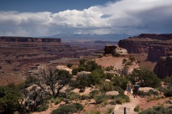 Sightseers walk along a path in Canyonlands.