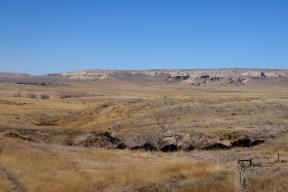 Eastern Wyoming ranch near the foot of a mesa. Cattle near the left-middle of the photo.