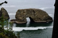 Wind and waves erode a tunnel through this coastal rock formation.