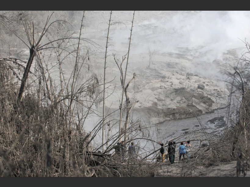 Villagers inspect the path of a pyroclastic flow from the eruption of Mount Sinabung in Gamber village, North Sumatra, Indonesia, Sunday, May 22, 2016. The volcano in western Indonesian unleashed hot clouds of ash on Saturday, killing several villagers, officals said. (AP Photo/Binsar Bakkara)/BB113/16143178481205/1605220710