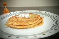 Delicious Whole Wheat Coconut Pancake with grated coconut on top.