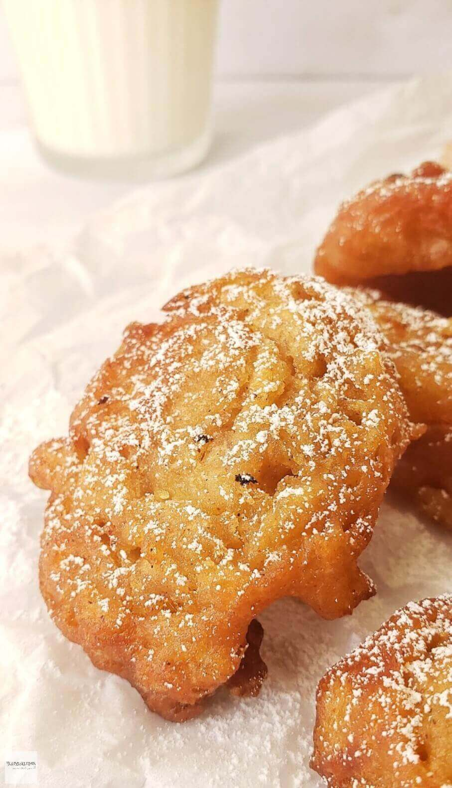 Powdered sugar dusted apple fritters.