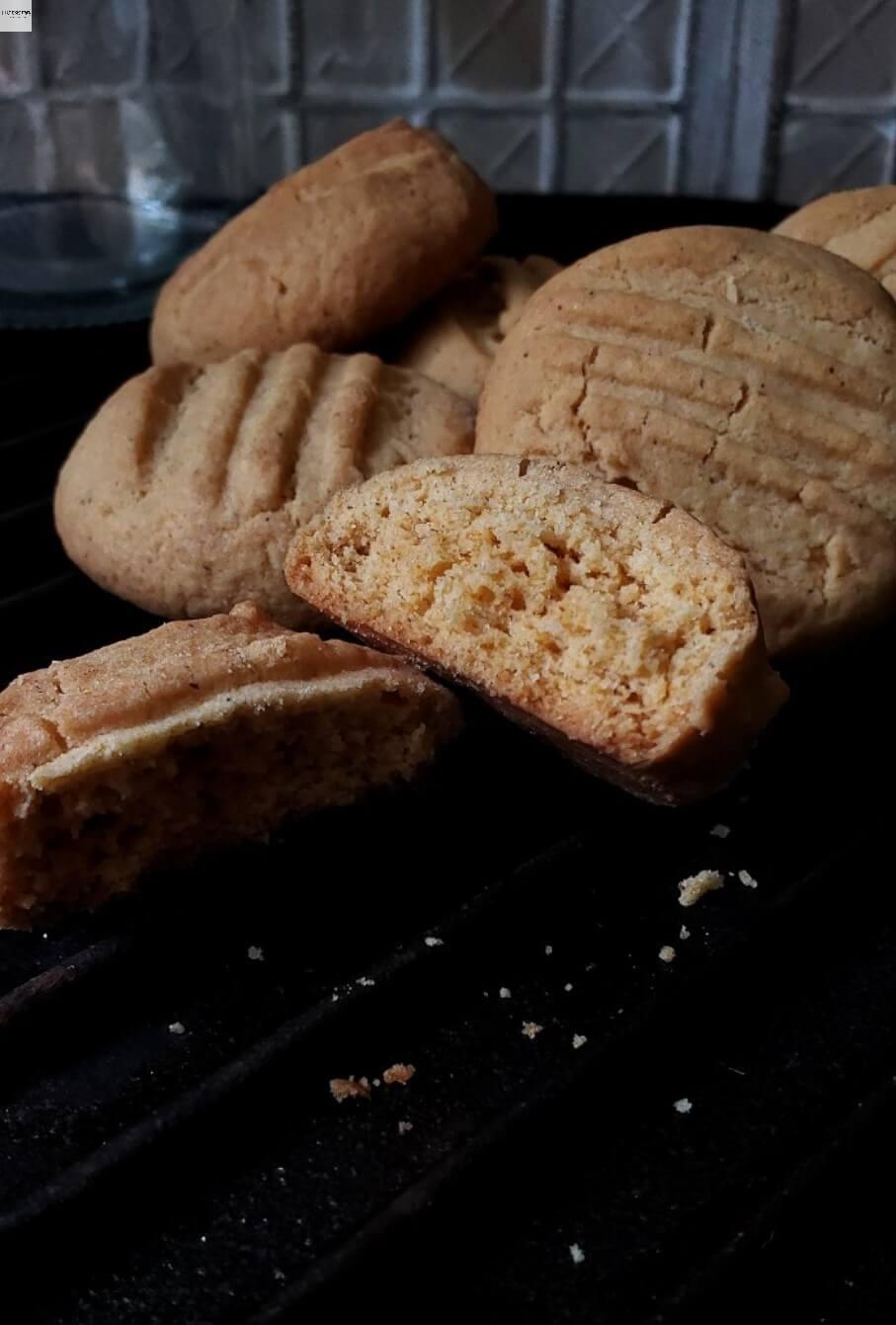 Eggless Custard cookies with half broken cookie.