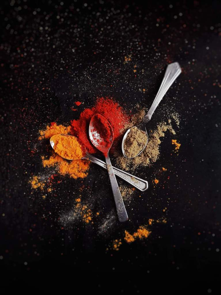 Spoons with spice powders.