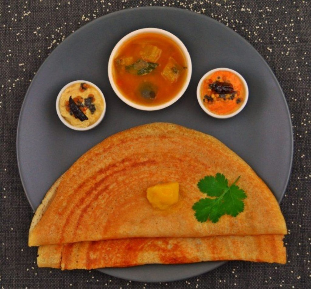Plate of millet dosa with chutneys.