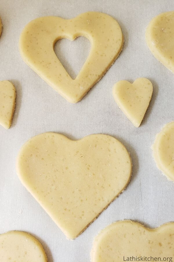Cut out cookie dough in heart shape.