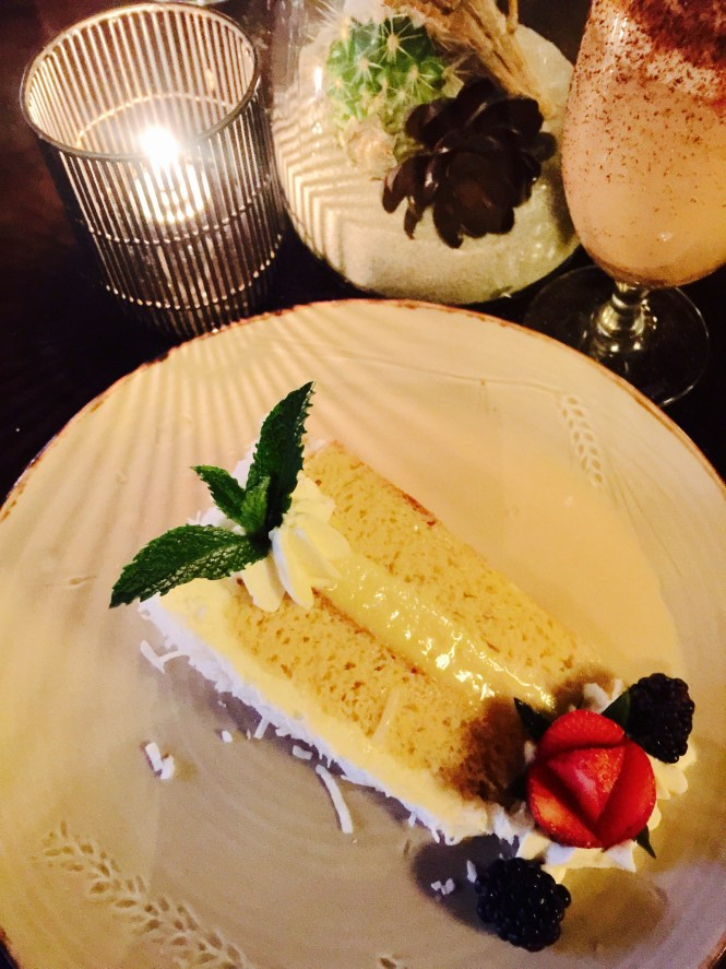 """Signature"" Coconut Tres Leches Vanilla Cake, centered with coconut flan"