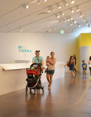 Denver residents enjoy the free first Saturday access to the Mi Tierra exhibit at the Denver Museum of Art.